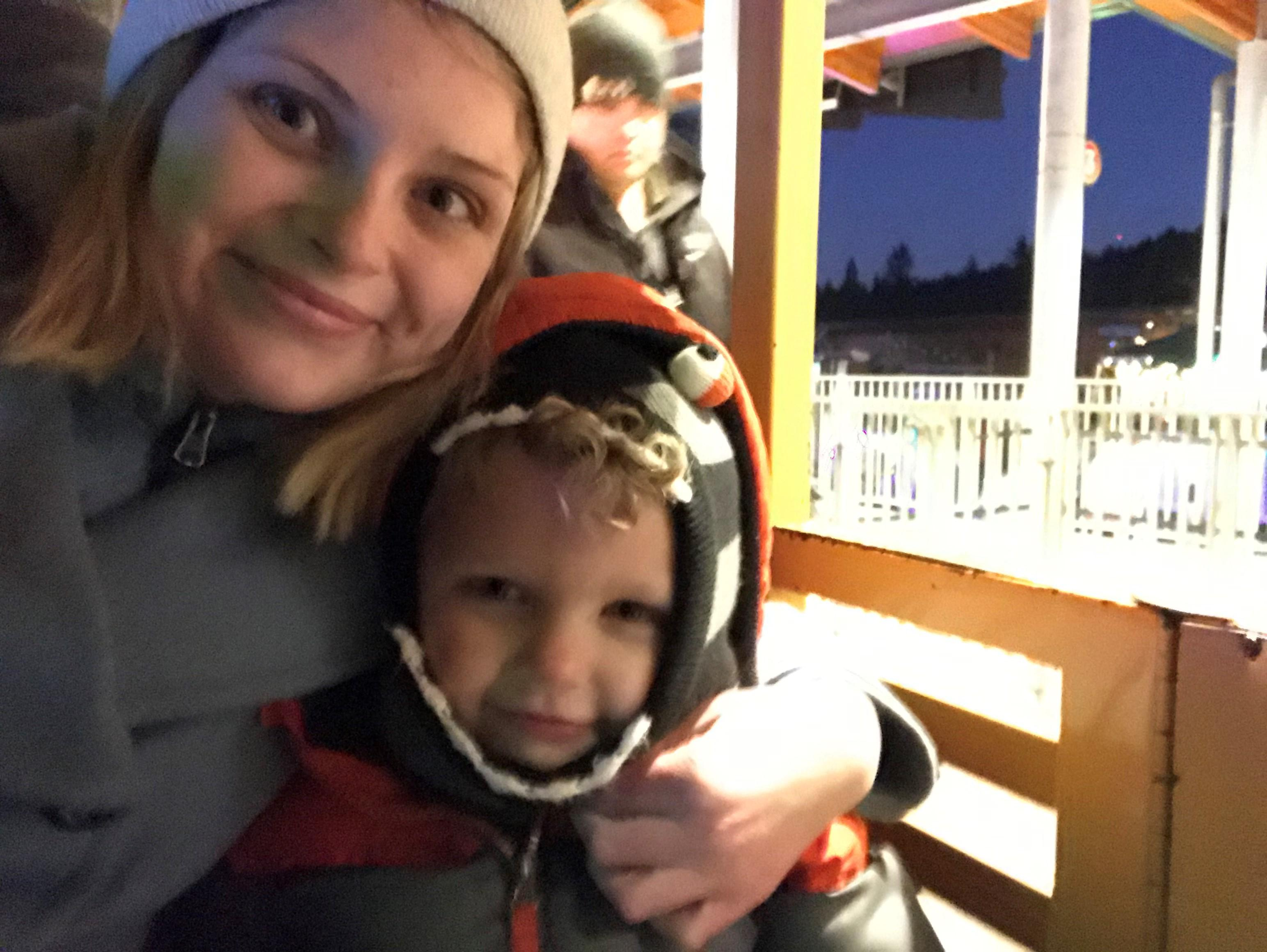 Steph and her son on the train at the Oregon zoo for zoolights